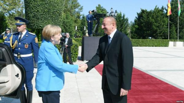 Merkel And Aliyev Hold 'Open' Talks On Human Rights In Azerbaijan